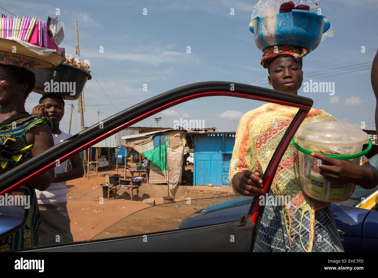 LOME, TOGO, 9th December 2012; Street sellers with food and goods - Stock Image