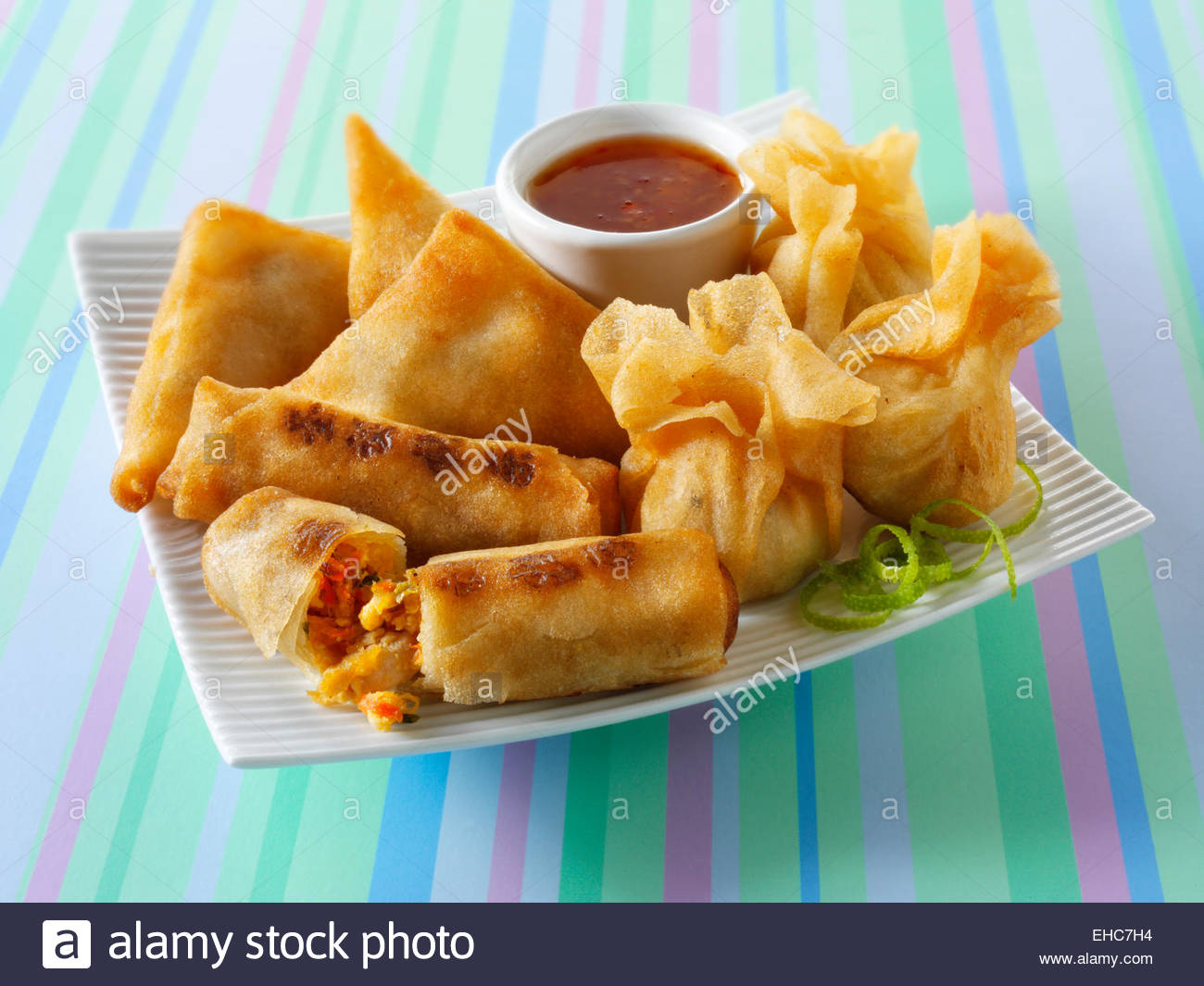 Chinese oriental spring rolls, samosas and dim sum - Stock Image