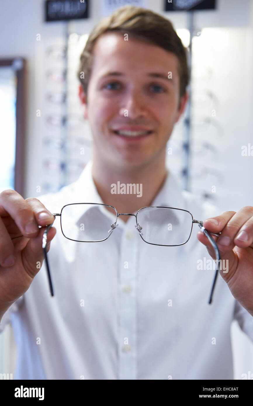 Optician Fitting New Glasses For Client - Stock Image