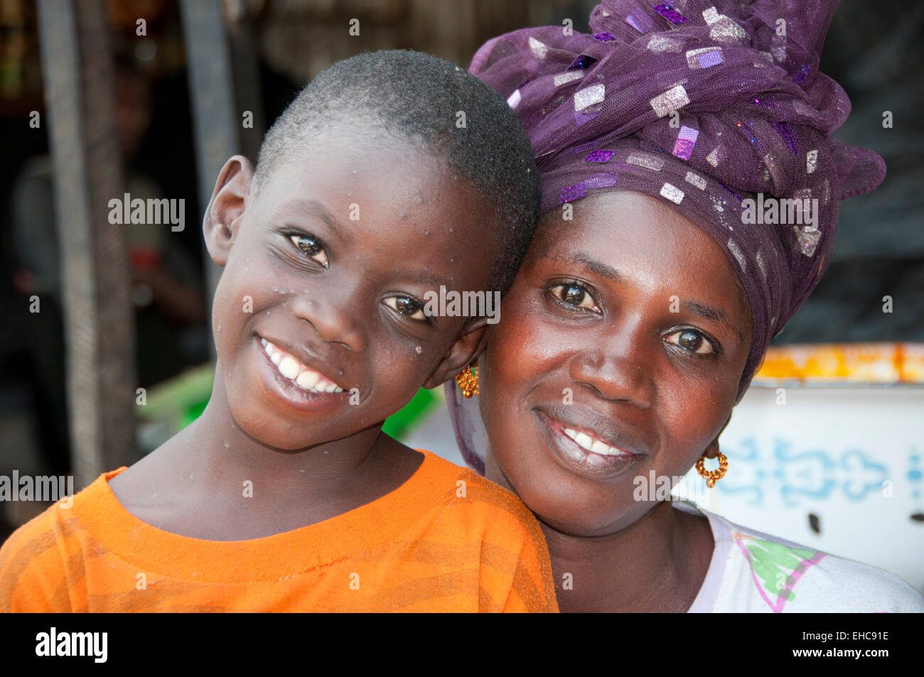 Portrait of Gambian Woman Market Trader and her Son, Serrekunda Market, The Gambia, West Africa - Stock Image