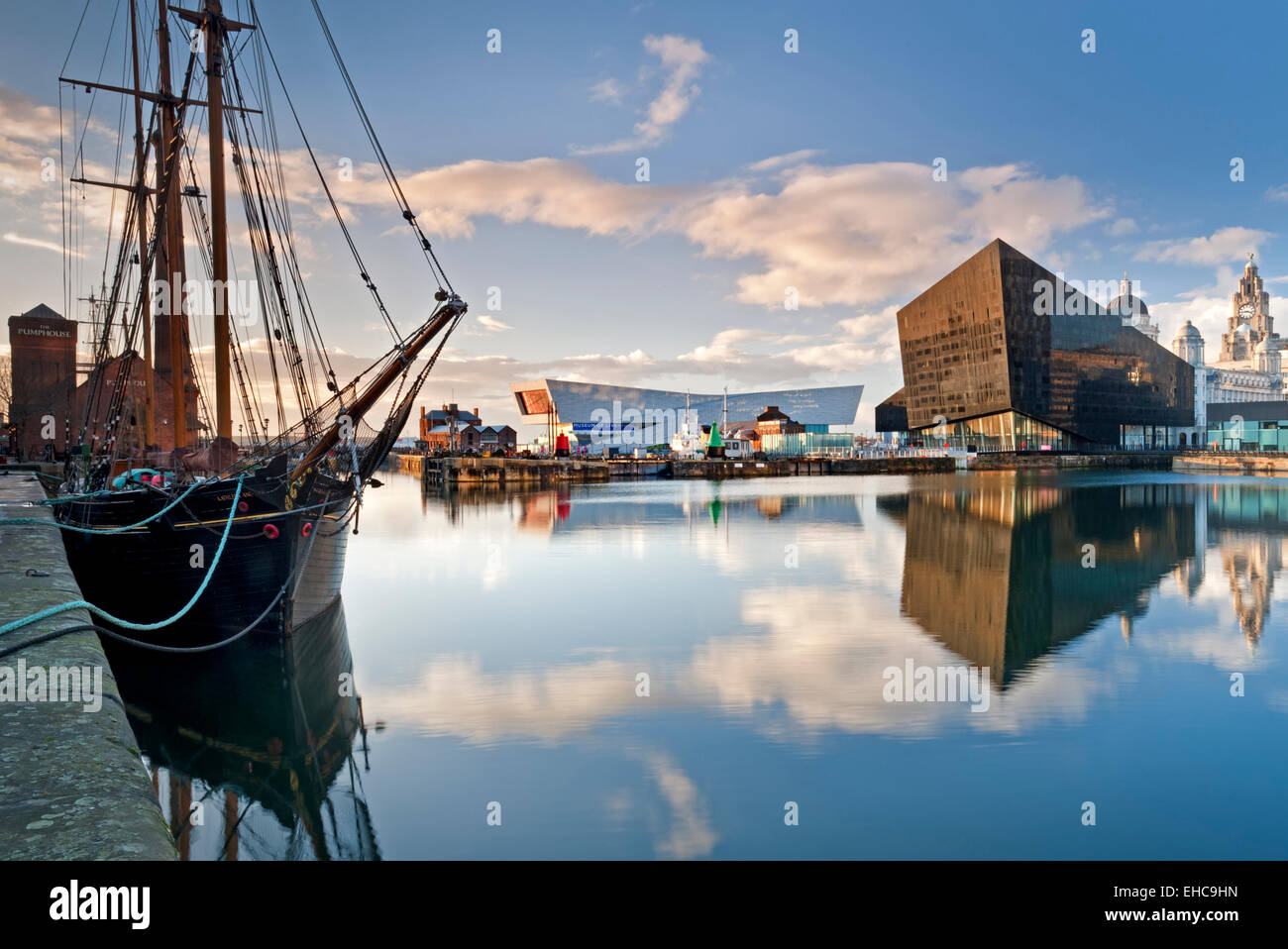 Tall Ship, Mann Island Apartments and Liverpool Museum, across Canning Dock, Liverpool, Merseyside, England, UK - Stock Image