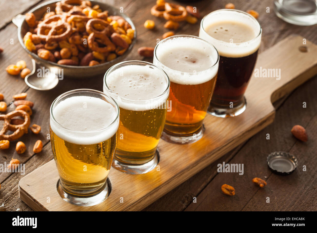 Assorted Beers in a Flight Ready for Tasting Stock Photo
