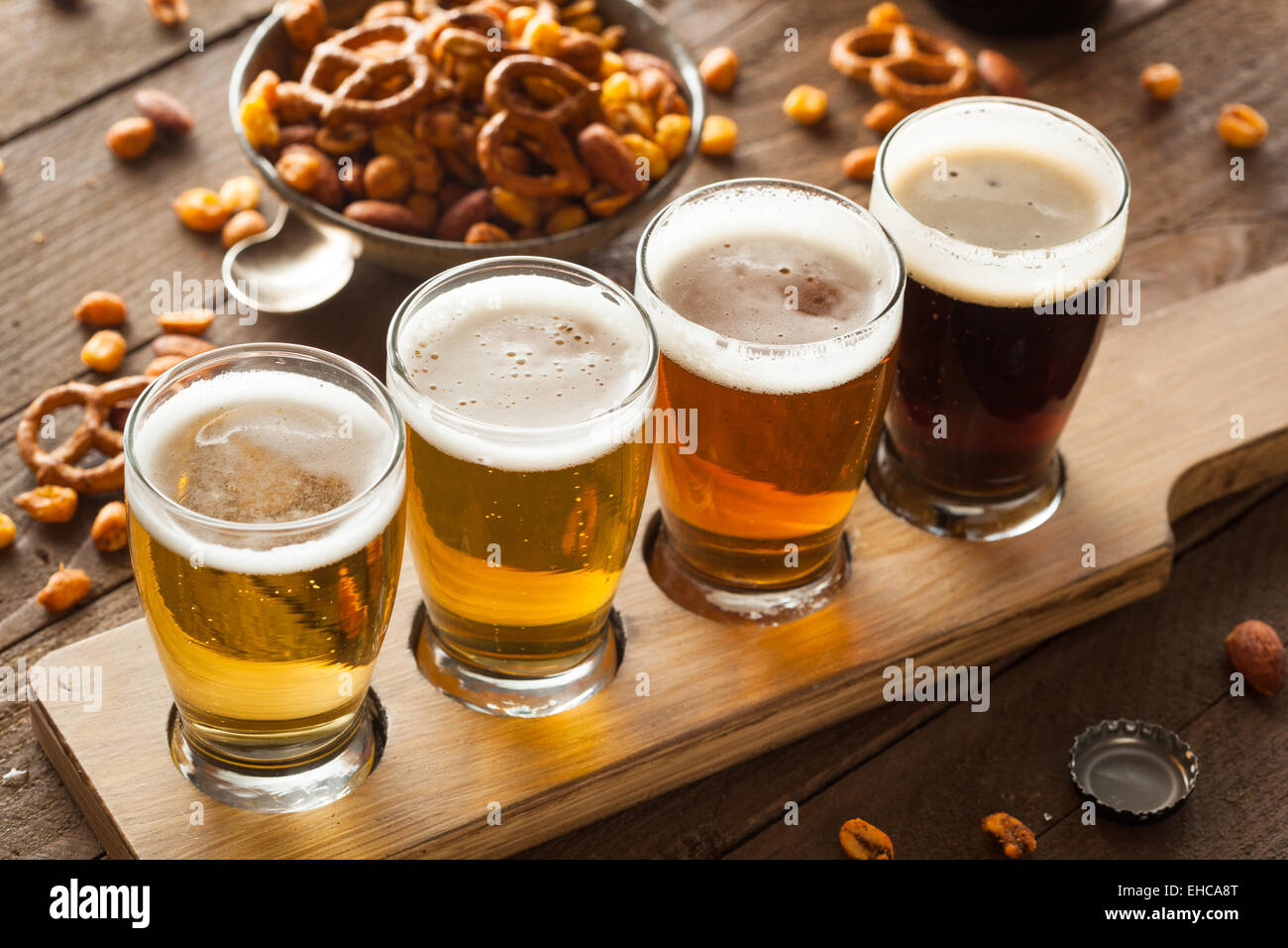 Assorted Beers in a Flight Ready for Tasting - Stock Image