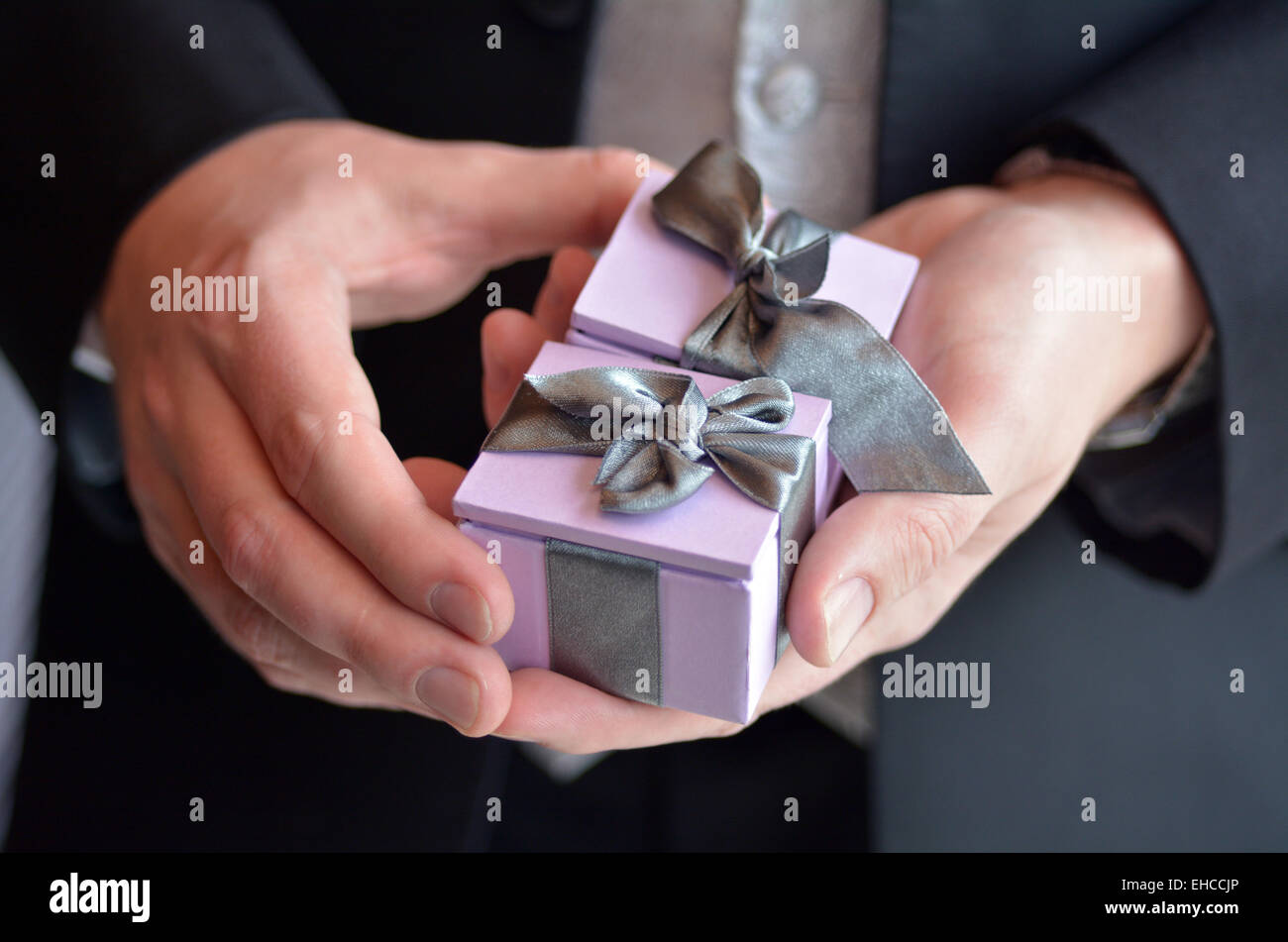 Man presents engagement rings. Concept of wedding, marriage, wealth and luxurious lifestyle - Stock Image