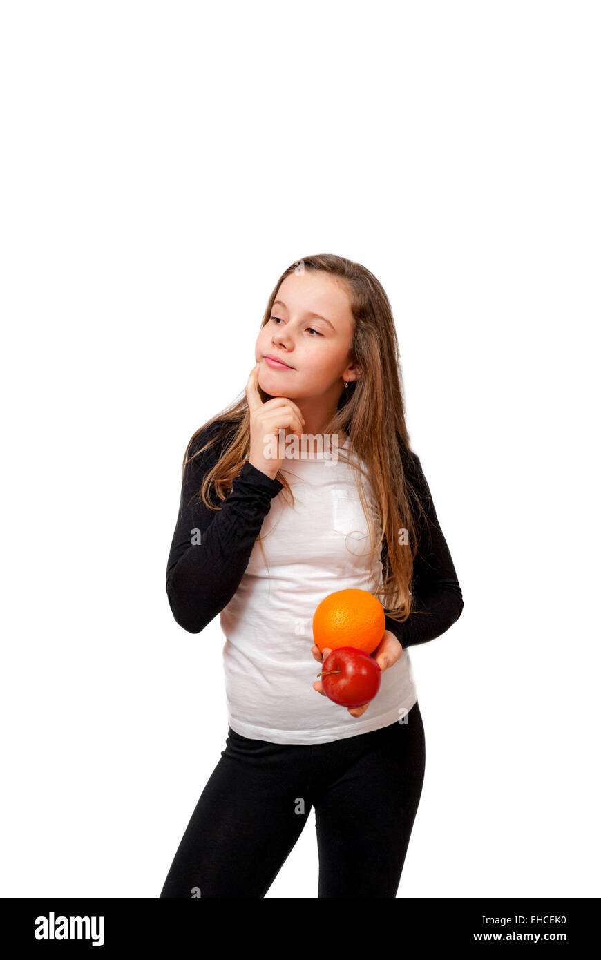 Thinking little girl with orange and apple isolated on white - Stock Image