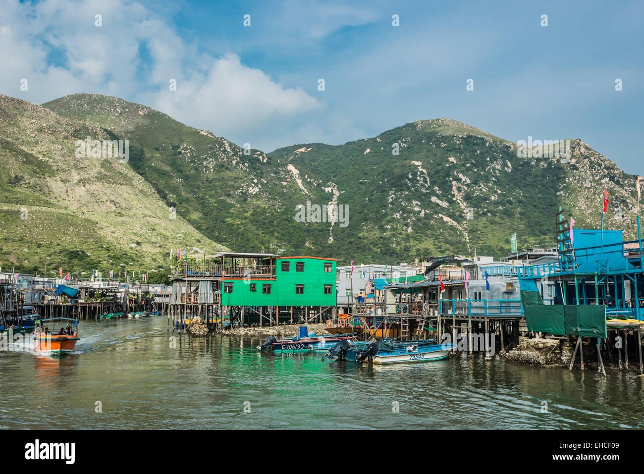 Tai O, Hong Kong, China- June 10, 2014: stilt houses and fishermen motorboats in Lantau island - Stock Image