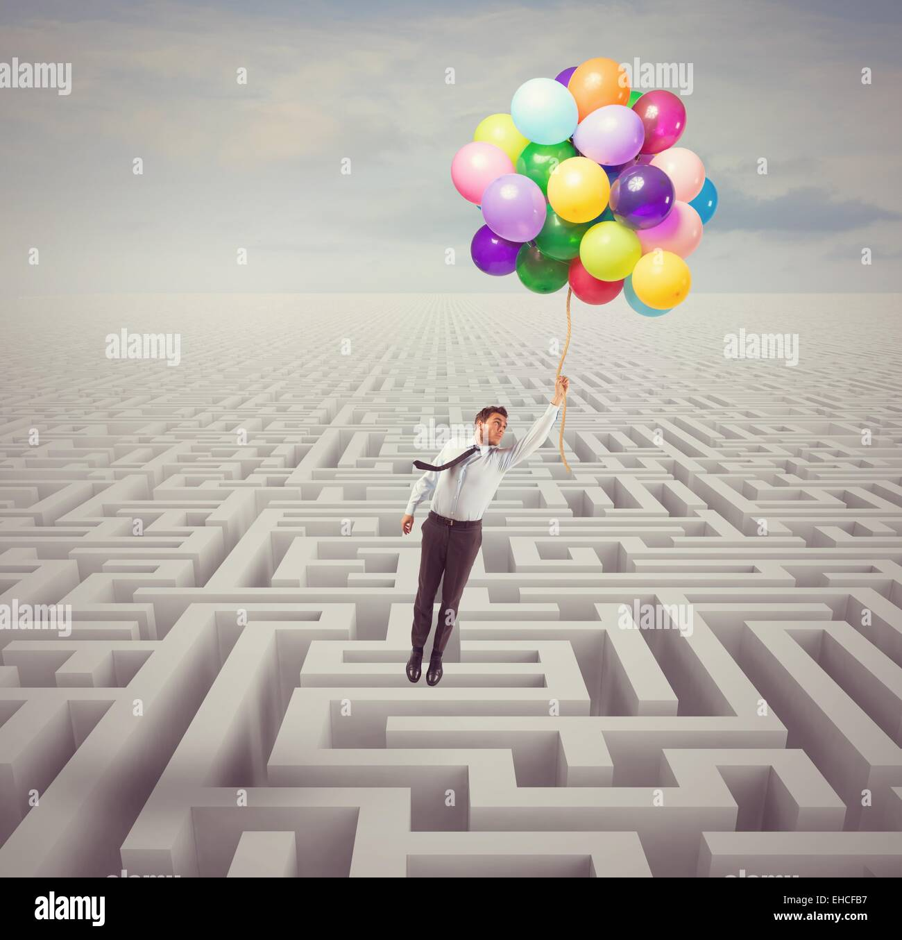 Businessman overcomes obstacles - Stock Image
