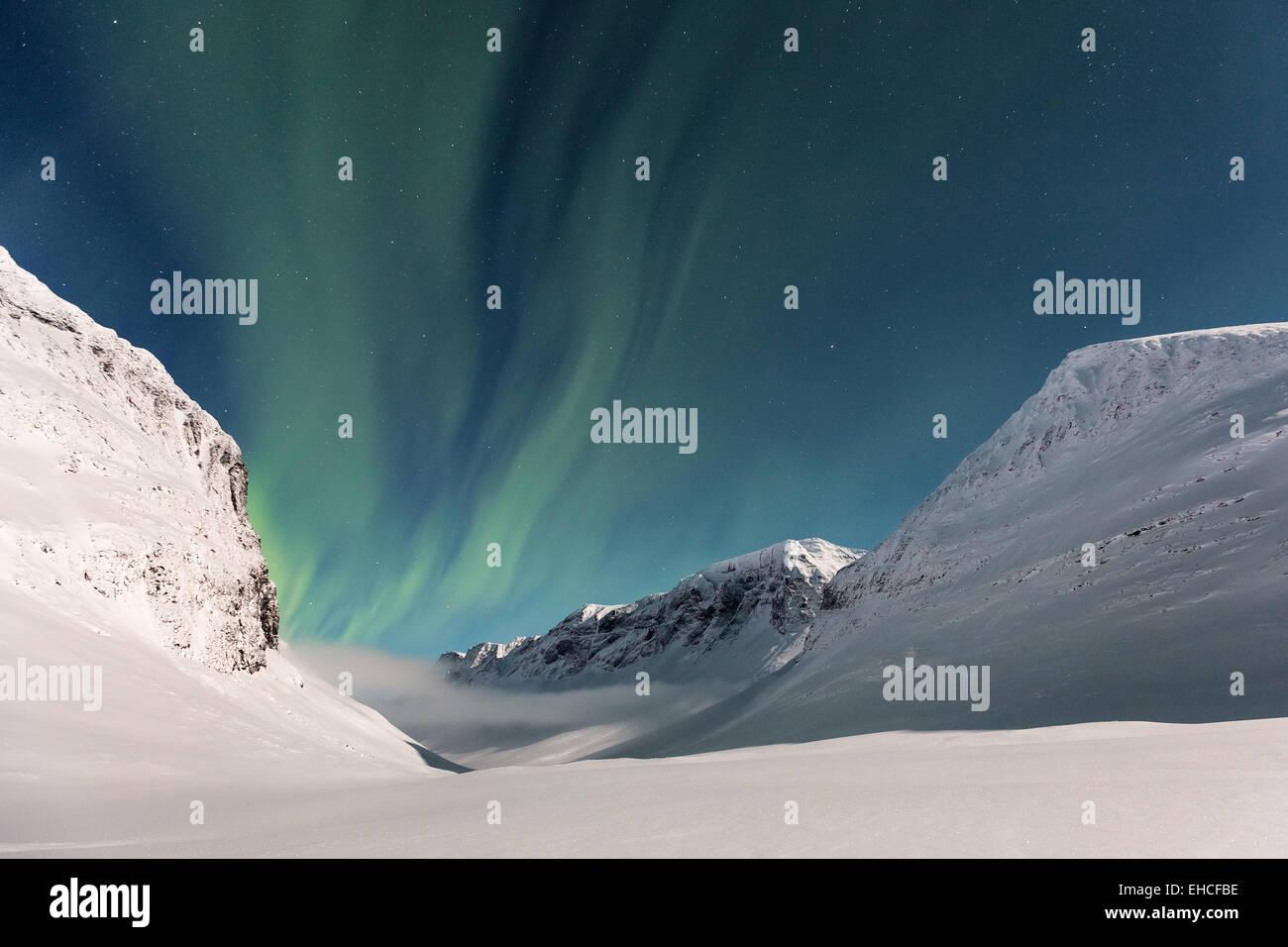 Northern lights seen at Nallostugan wilderness hut, Kebnekaise mountain area, Kiruna, Sweden, Europe, EU - Stock Image