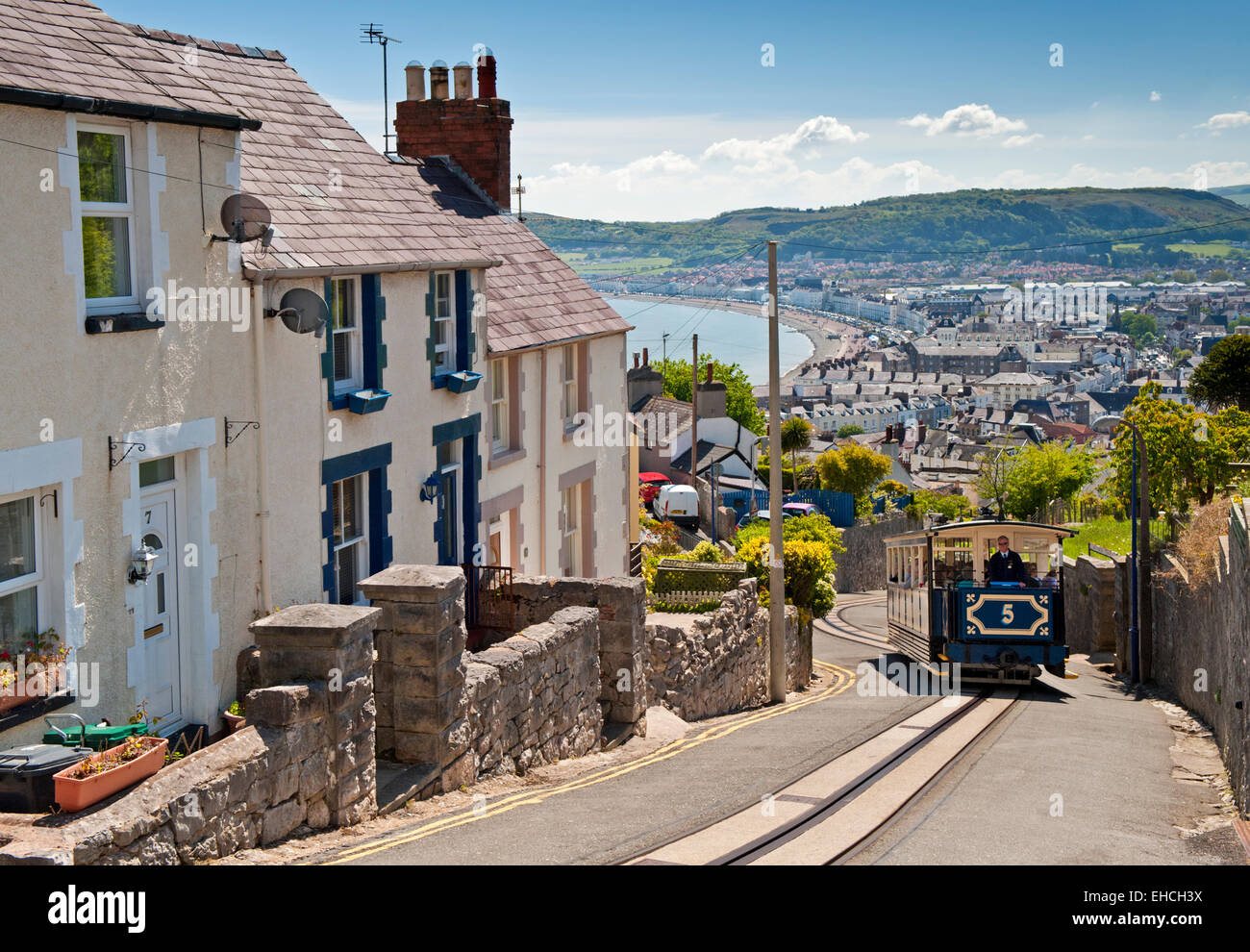 Great Orme Tramway Tram Climbing the Hills above Llandudno Seafront, Llandudno, North Wales, UK Stock Photo