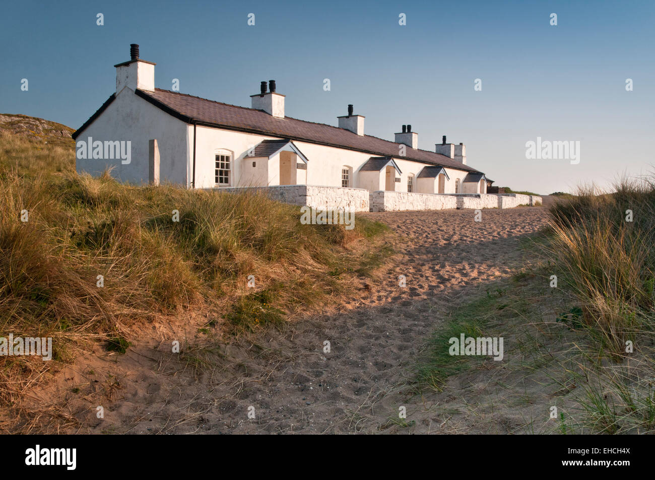 Whitewashed Pilots Cottages, Llanddwyn Island, Anglesey, North Wales, UK - Stock Image