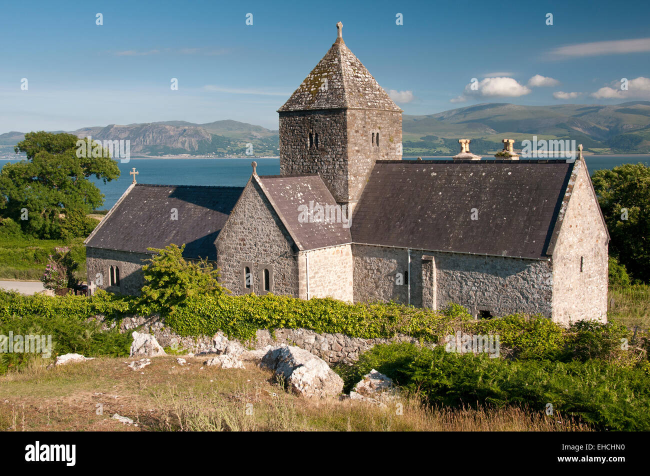 Penmon Priory and the Menai Straits, Near Beaumaris, Anglesey, North Wales, UK - Stock Image
