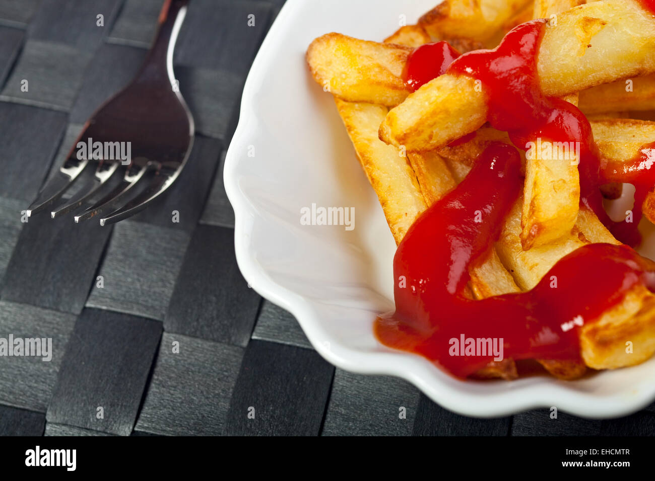 french fries on a typical plate - Stock Image