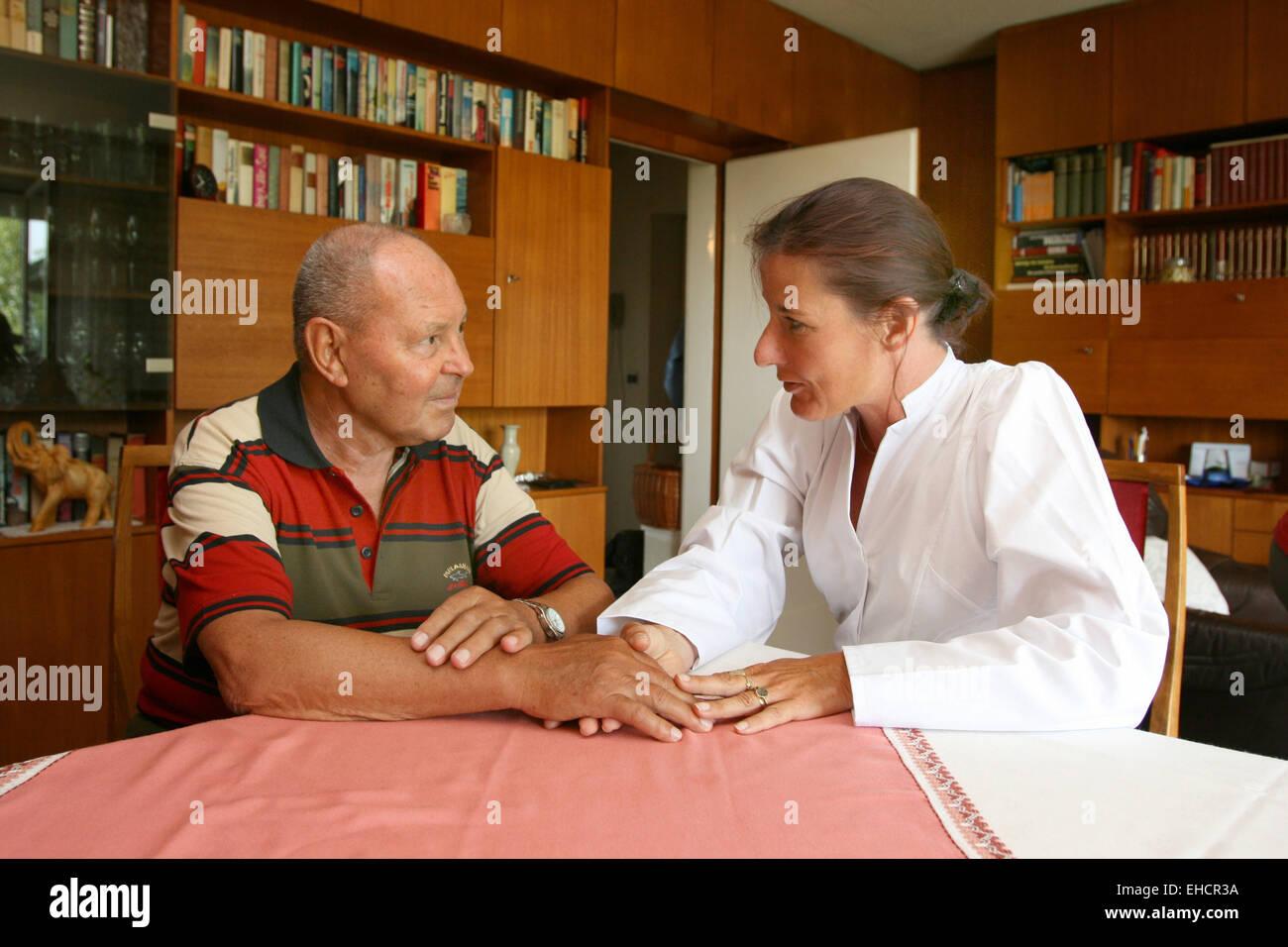 Senior citizen with nurse Stock Photo