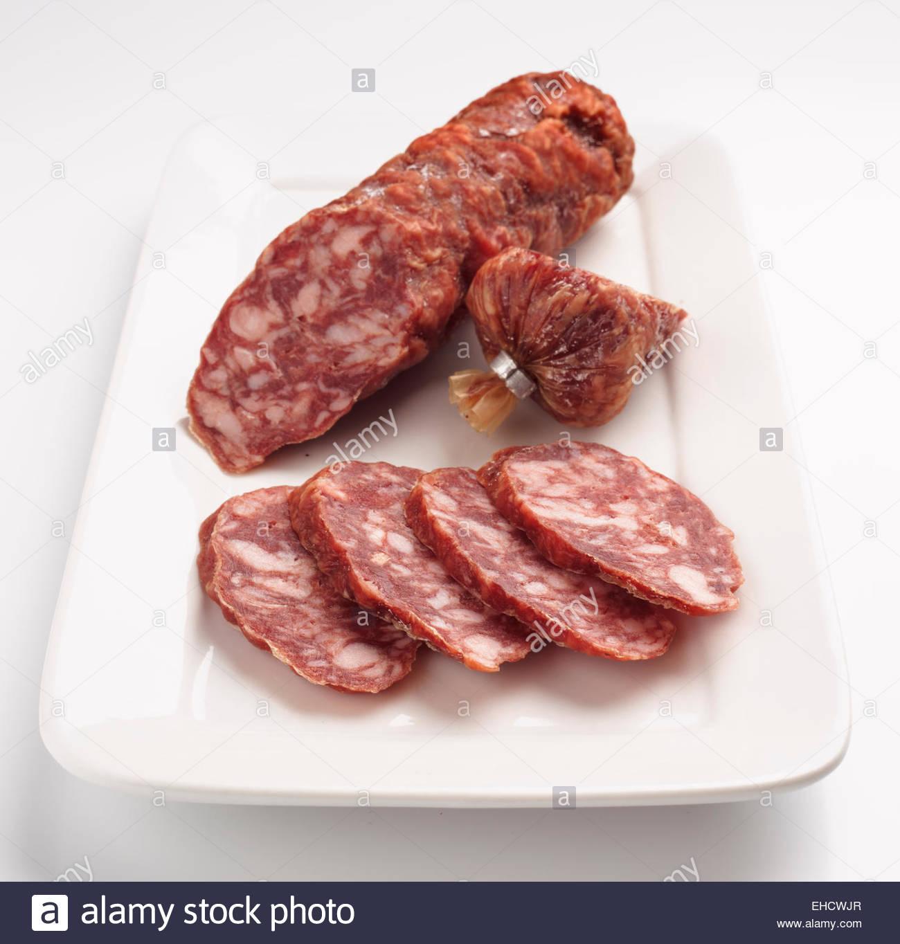 Spanish sausage on white tray Stock Photo