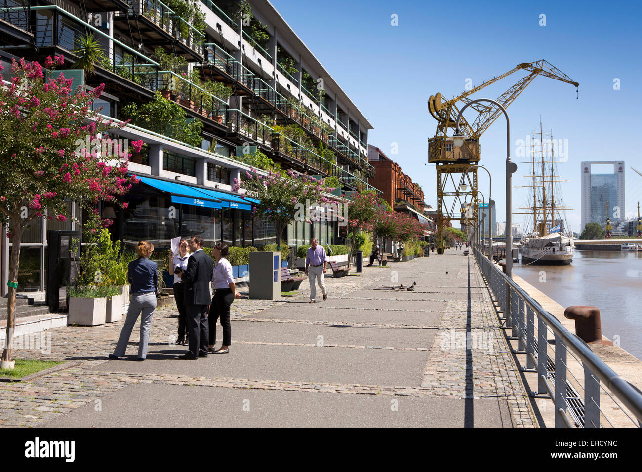 Argentina, Buenos Aires, Puerto Madero, quayside restaurants & apartments in old warehouses beside Frigate Presidente Stock Photo