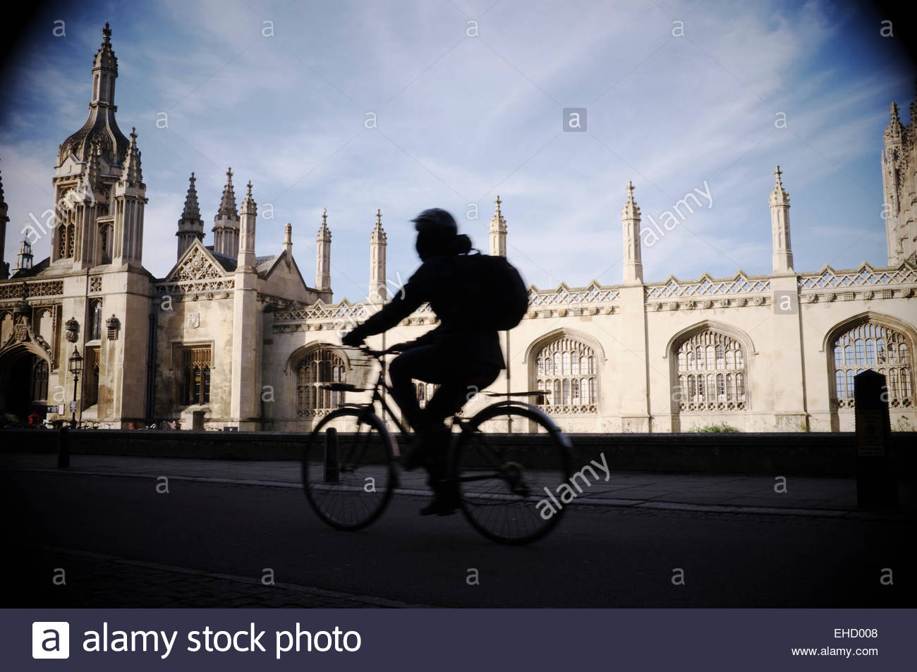 A cyclist travels along King's Parade, with King's College providing a backdrop. Cambridge, Cambridgeshire, - Stock Image
