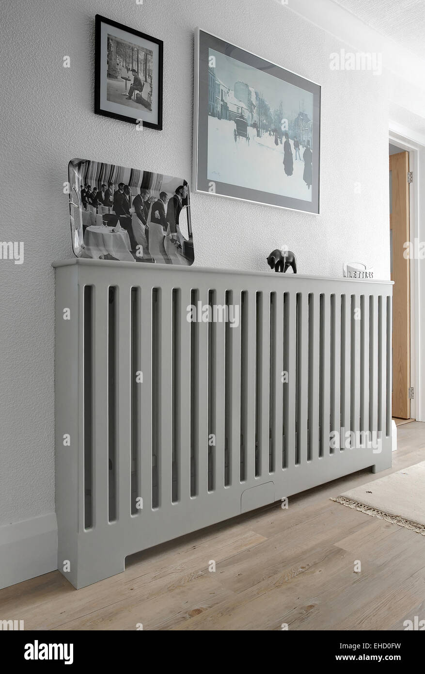 A Wooden Radiator Cover Hiding A Radiator In A Hallway In A Uk Home Stock Photo Alamy