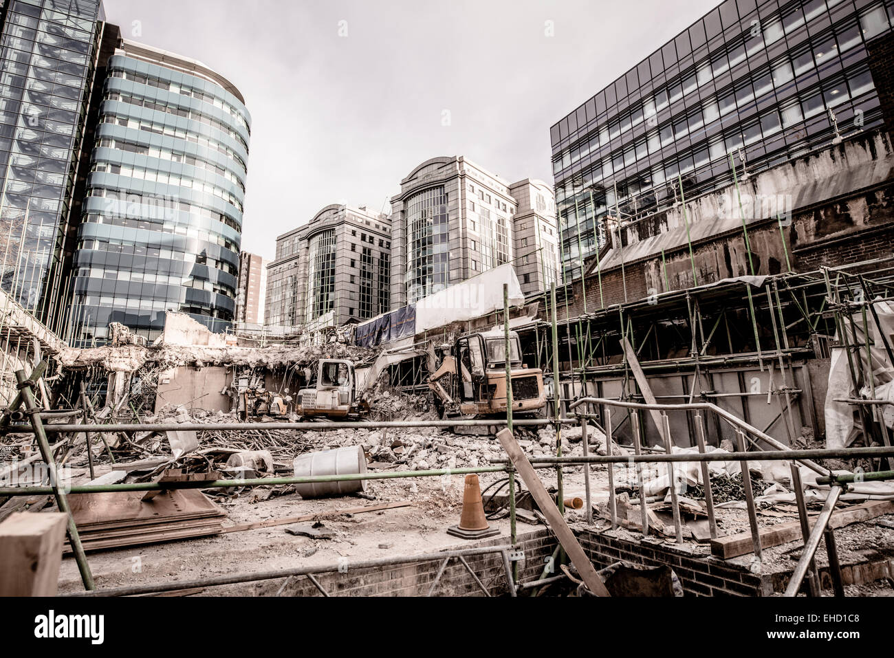 Building construction with modern offices in the background - Stock Image
