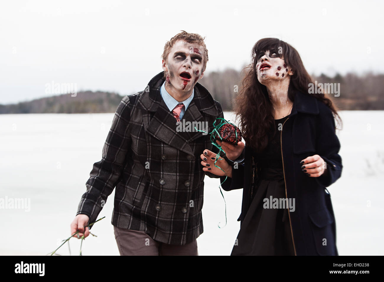 Zombies getting insane from smell of brains - Stock Image