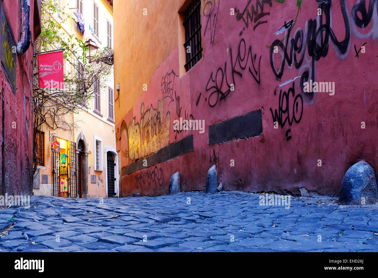 Graffiti on the walls of Vicolo del Bollo, Rome, Italy - Stock Image
