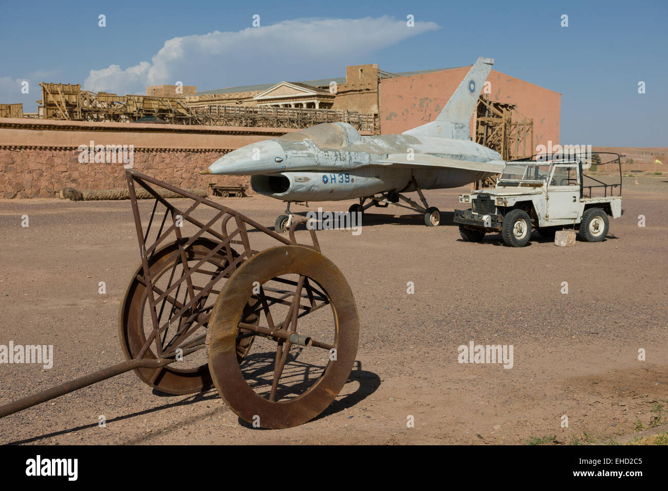 Plane from Jewel in the Nile and chariot from Ben Hur at the Atlas Corporation Film Studios, Ouarzazate, Morocco - Stock Image
