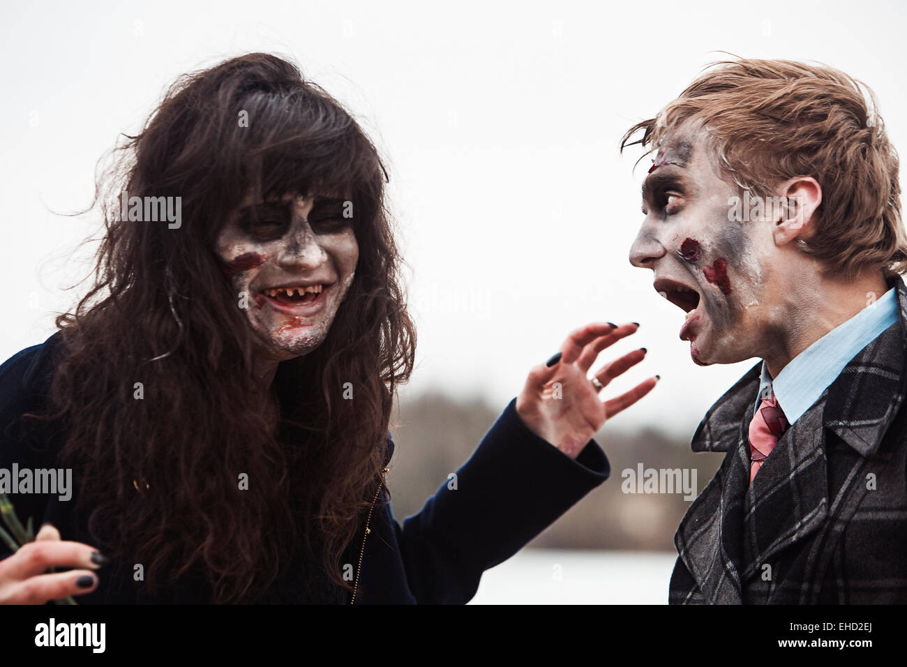 Toothless zombie woman and her frightened boyfriend - Stock Image