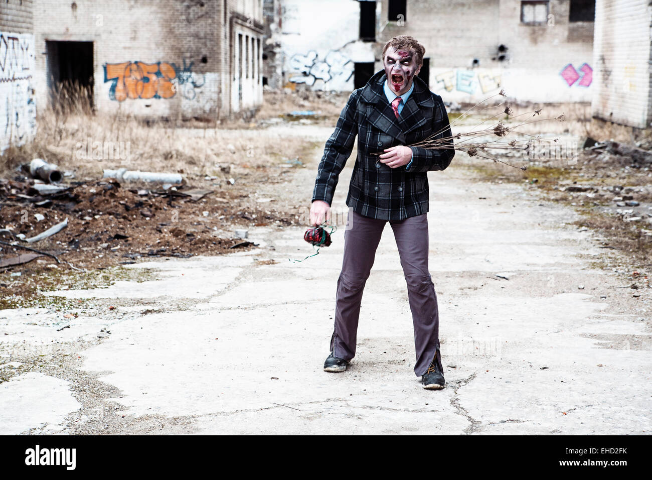 Male with creepy flowers in abandoned place Stock Photo
