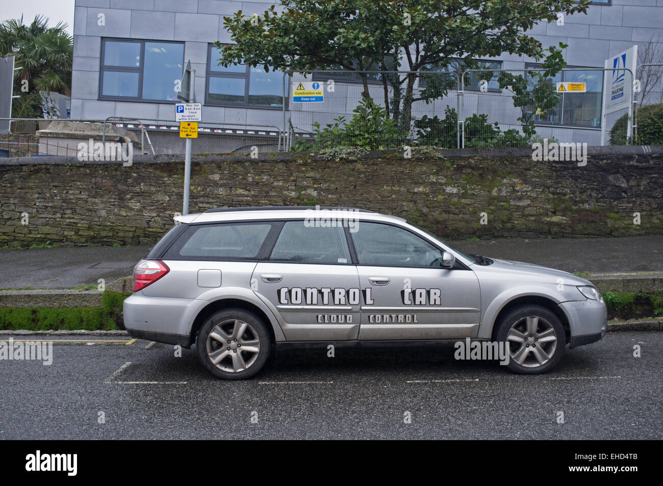 A car showing misleading/confusing messages on the side - Stock Image