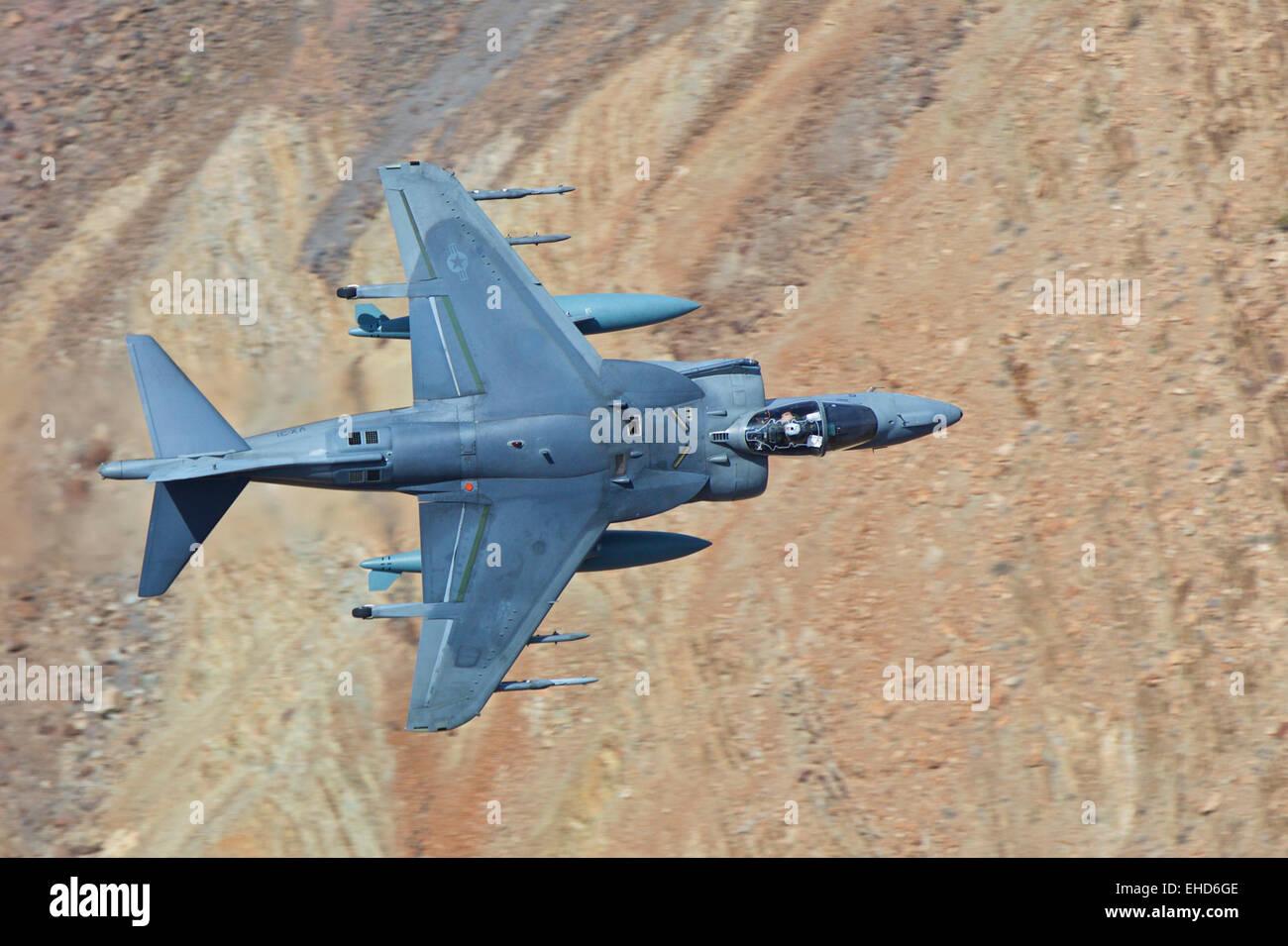 Marine Corps AV-8B Harrier II, Turning Hard As It Flies Low Through A Desert Canyon In The Mojave Desert, California, Stock Photo