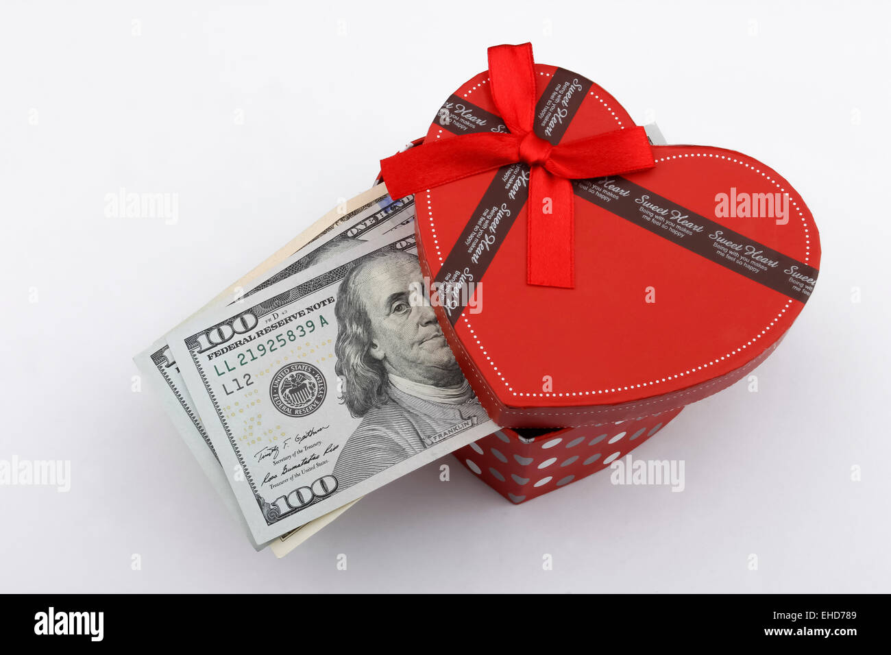 Love gift with US dollar bills (USD), in a red gift box. - Stock Image