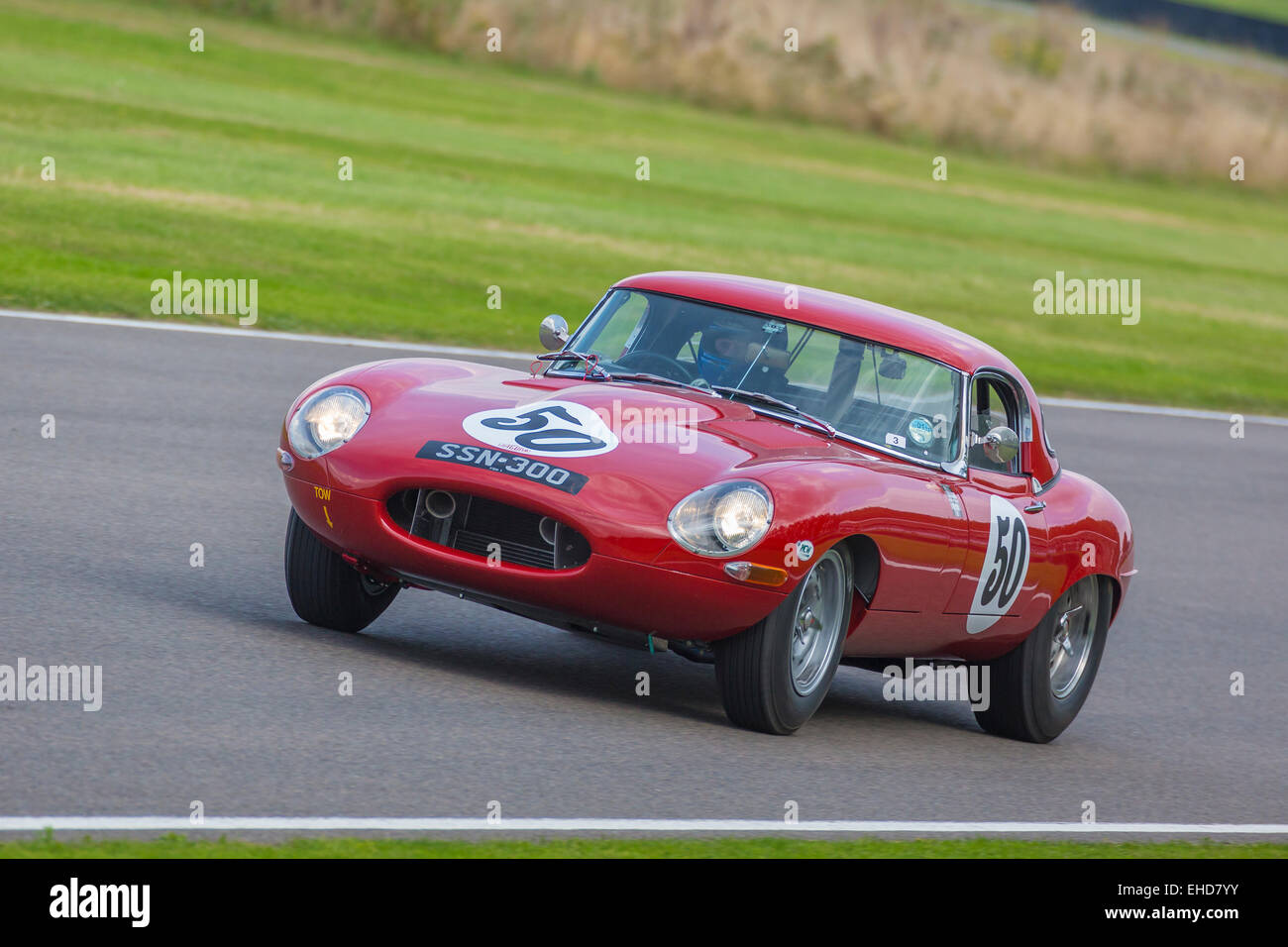 1961 Jaguar E-Type 'semi-lightweight' during the RAC TT Celebration race at the 2014 Goodwood Revival, Sussex, - Stock Image