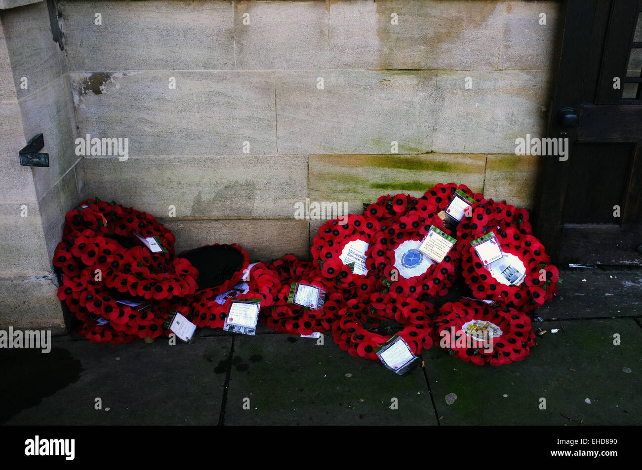A pile of poppy wreaths laying on the ground in Brighton, UK. - Stock Image