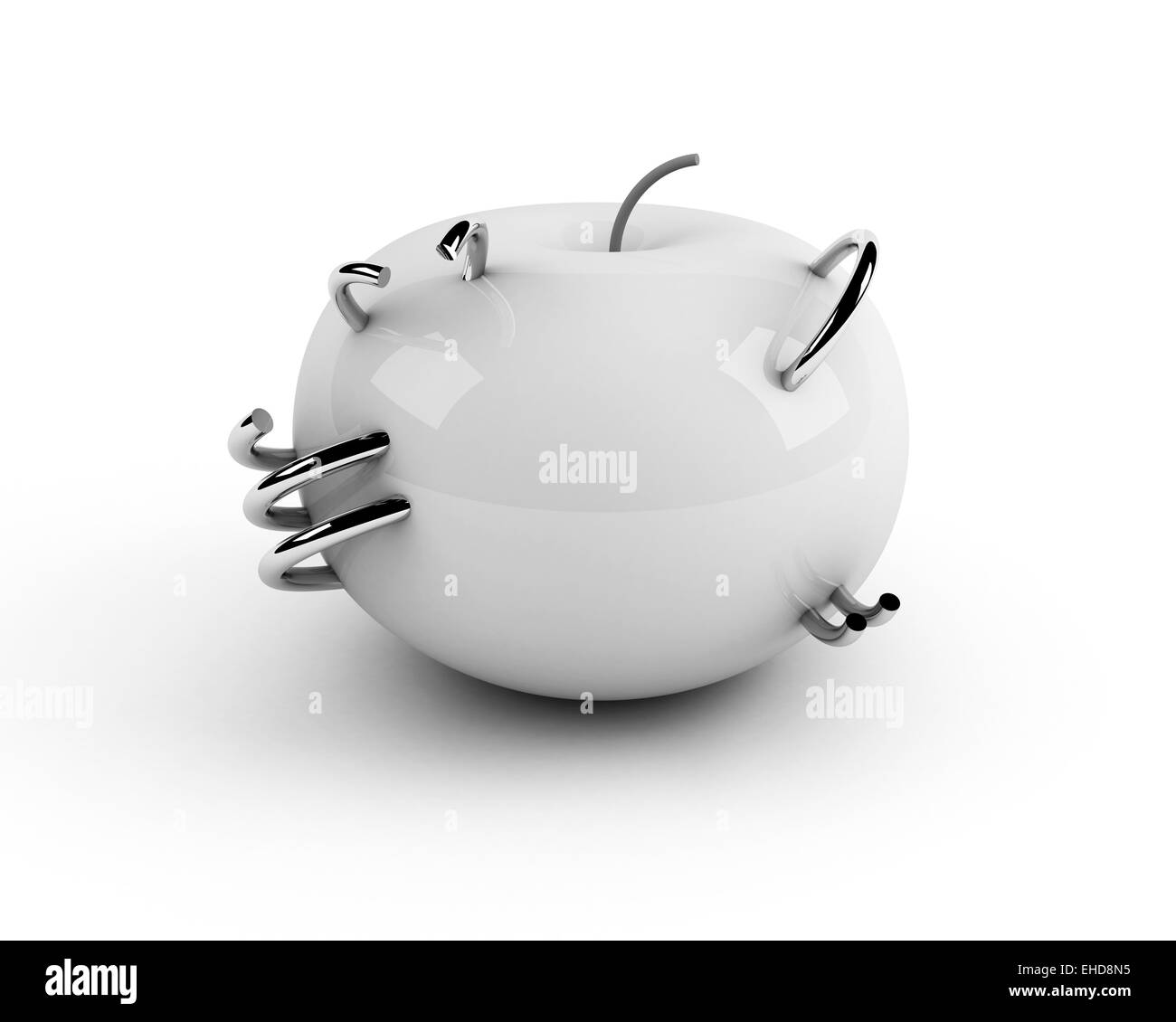 white artificial apple with steel rings - Stock Image