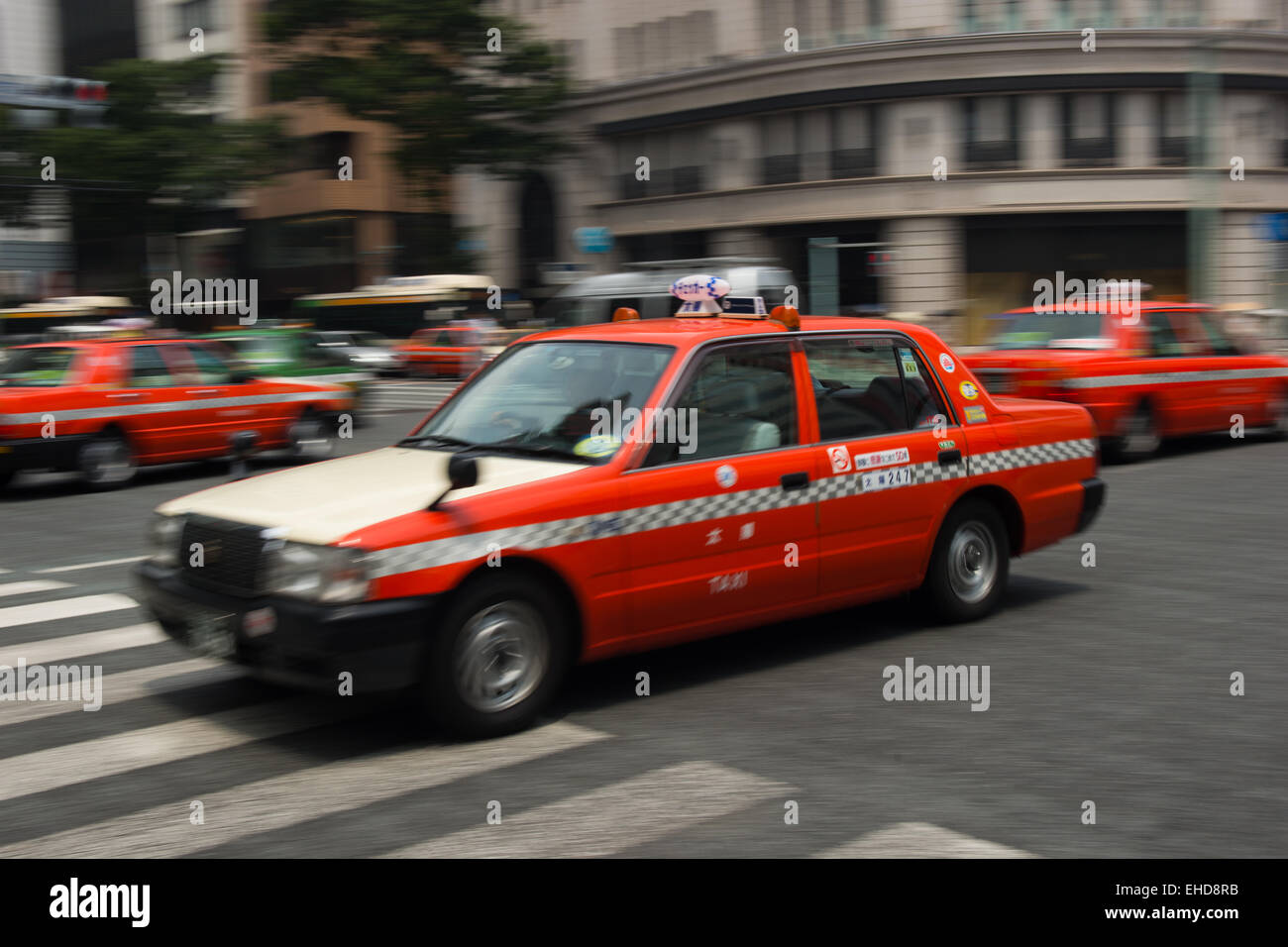 Taxis in Tokyo, Japan - At Ginza Station. - Stock Image