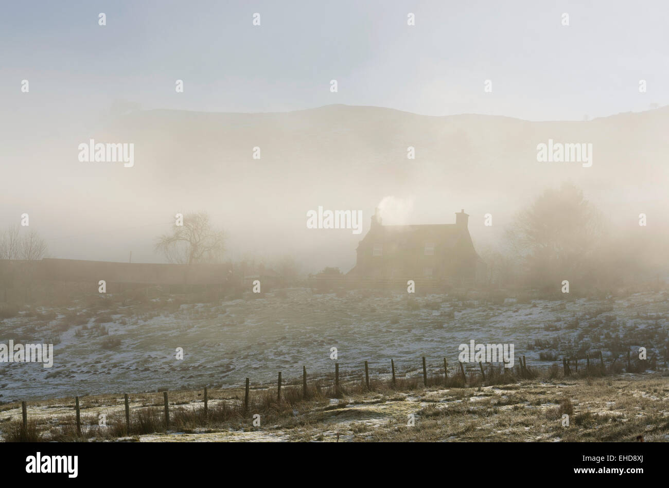 secluded cottage in ethereal mood with mystical lost in the mists of time feel - Stock Image