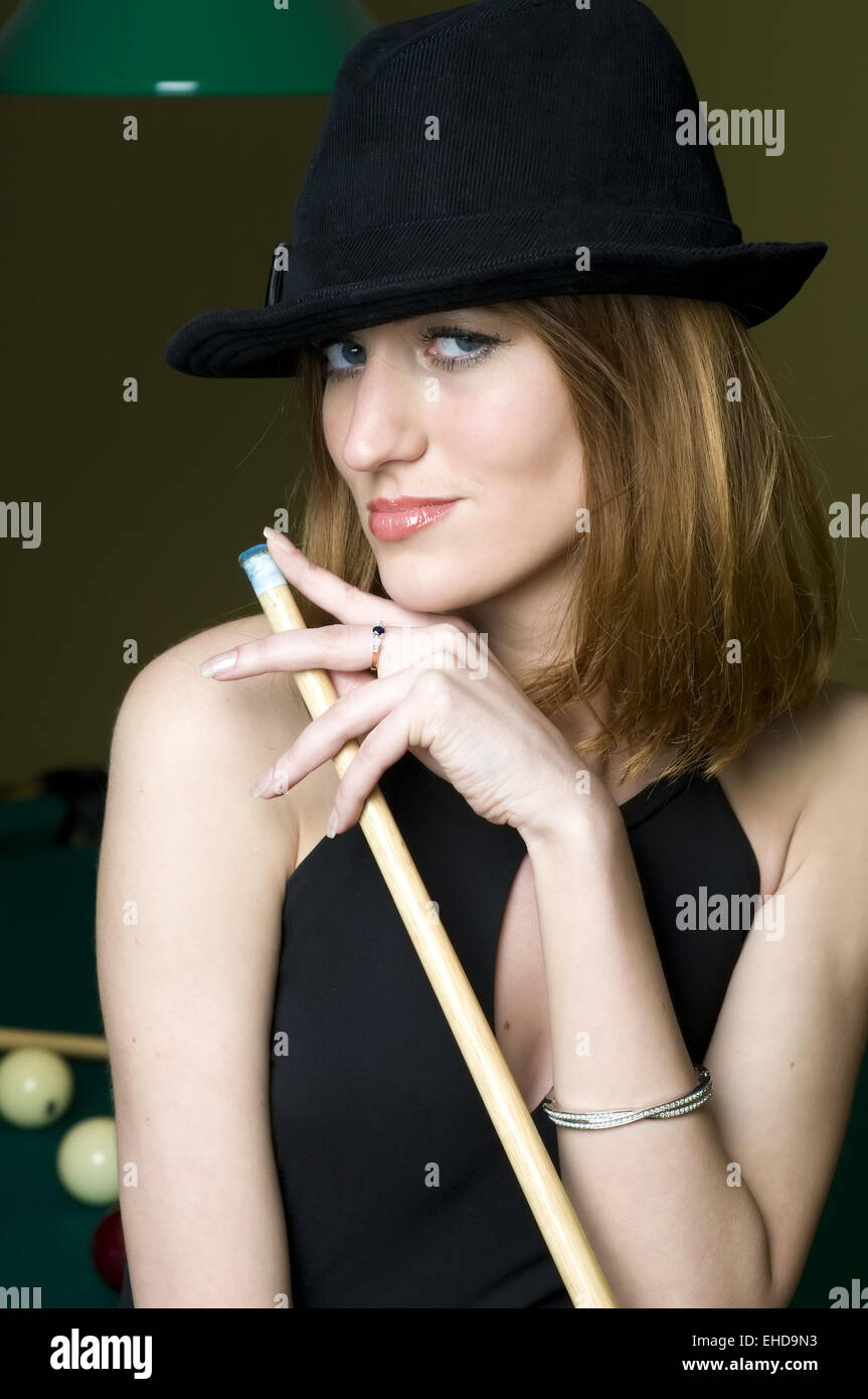 Woman with cue - Stock Image