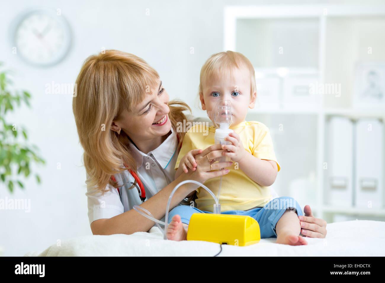 Doctor holding inhaler mask for child breathing - Stock Image