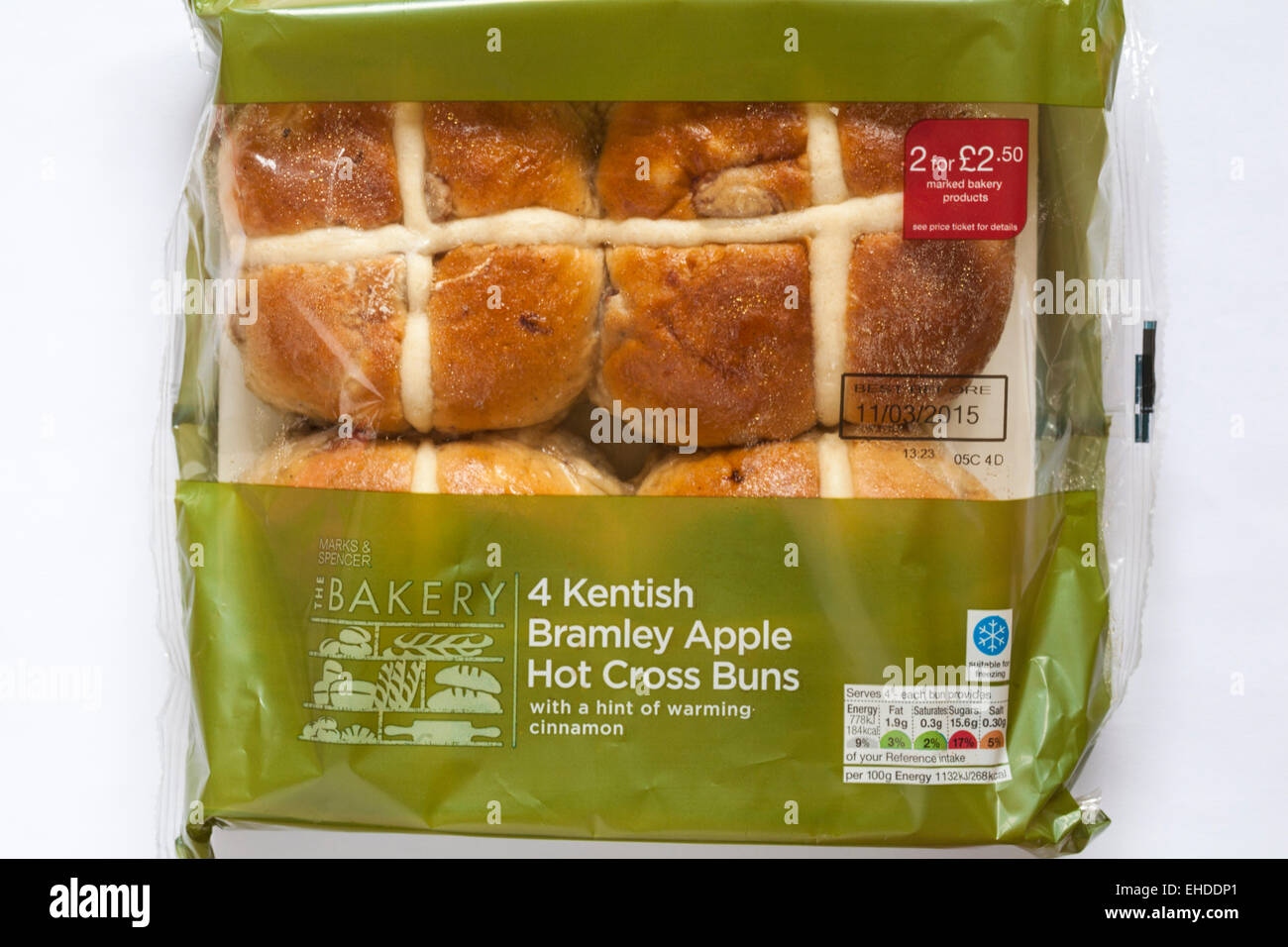 packet of Marks & Spencer 4 Kentish Bramley Apple Hot Cross Buns with a hint of warming cinnamon ready for Easter - Stock Image
