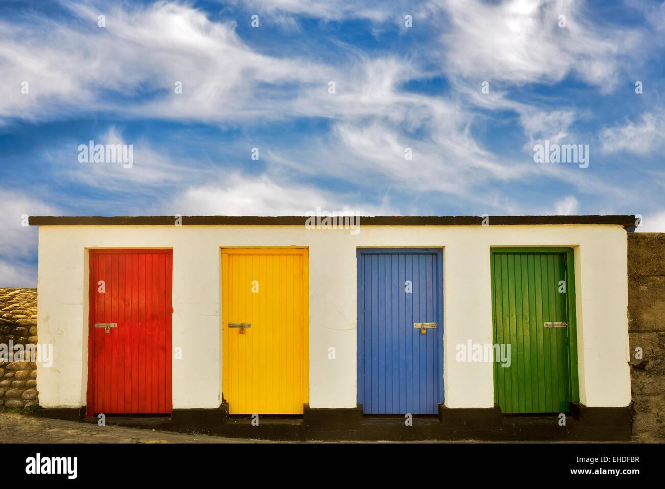 Colored doors. Inishfree Pier, Ennicrone, Ireland - Stock Image