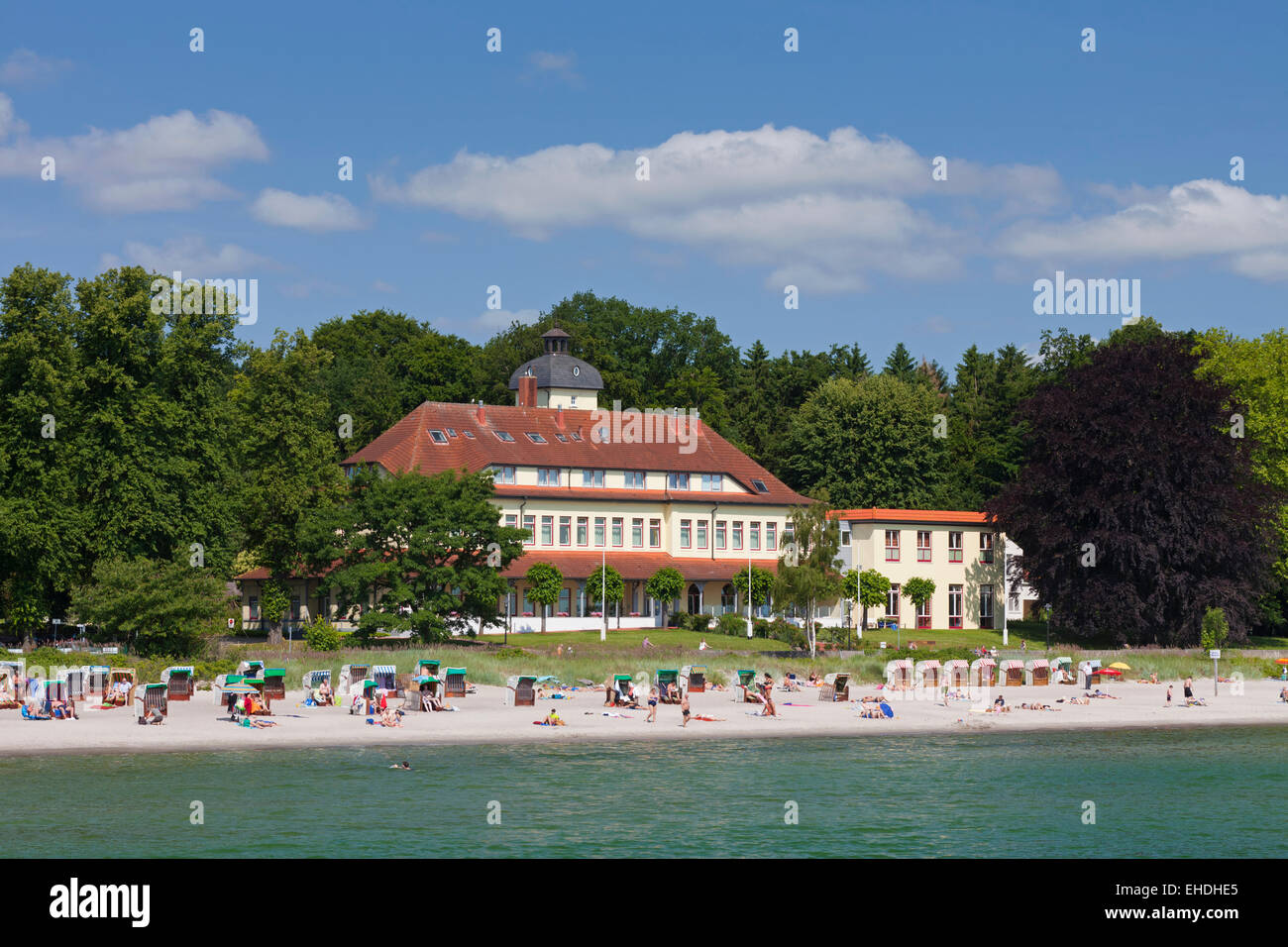The Henry Everling Haus and sunbathers in beach chairs at the seaside resort Haffkrug, Schleswig-Holstein, Germany - Stock Image