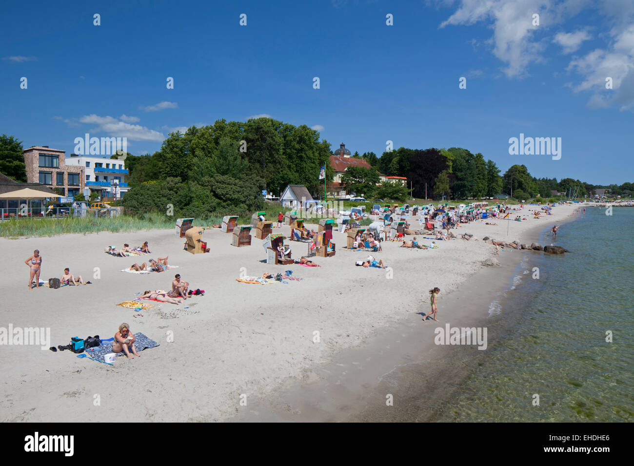Sunbathers in beach chairs at the seaside resort Haffkrug, Schleswig-Holstein, Germany - Stock Image