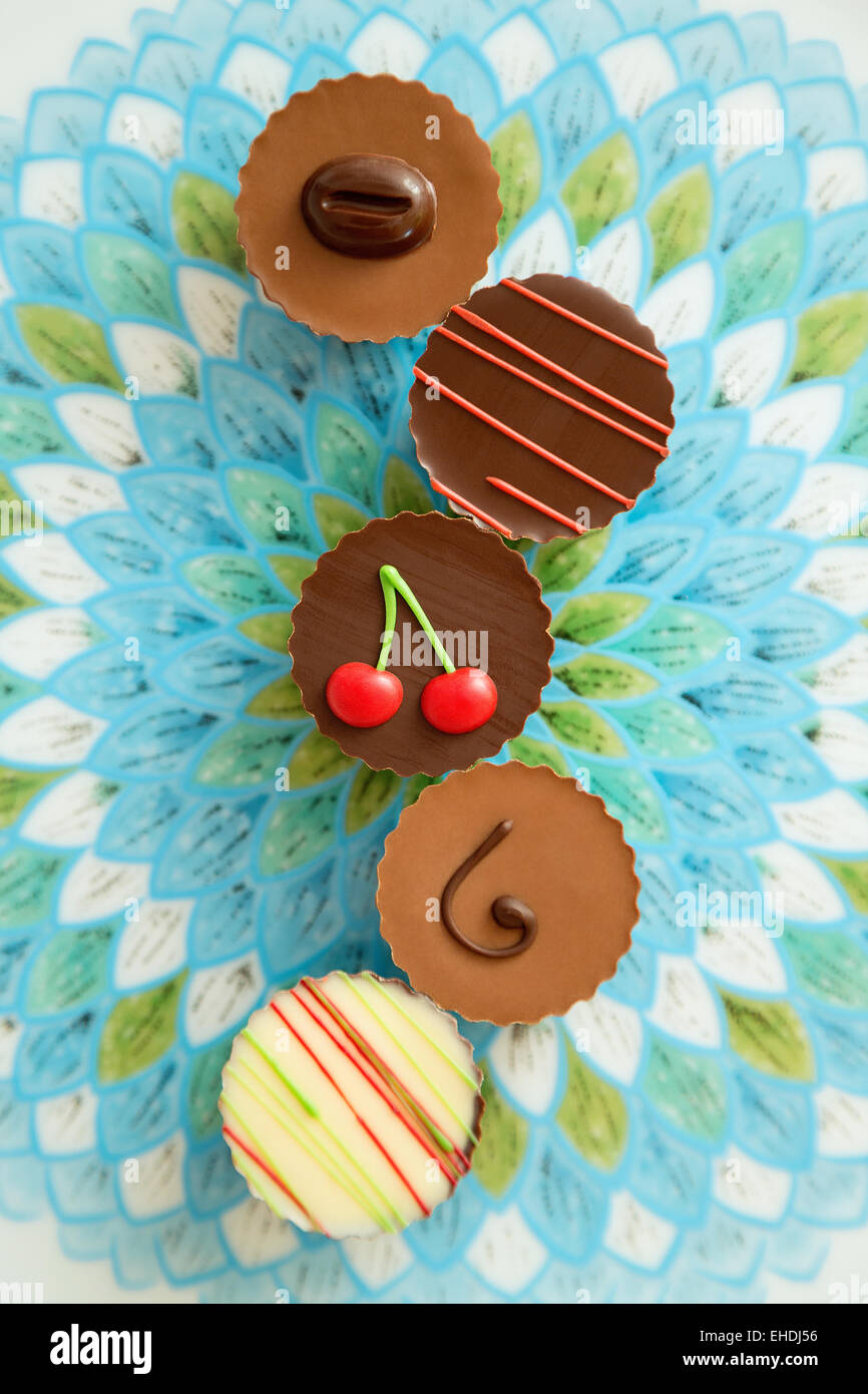 Colorful chocolate assortments - Stock Image