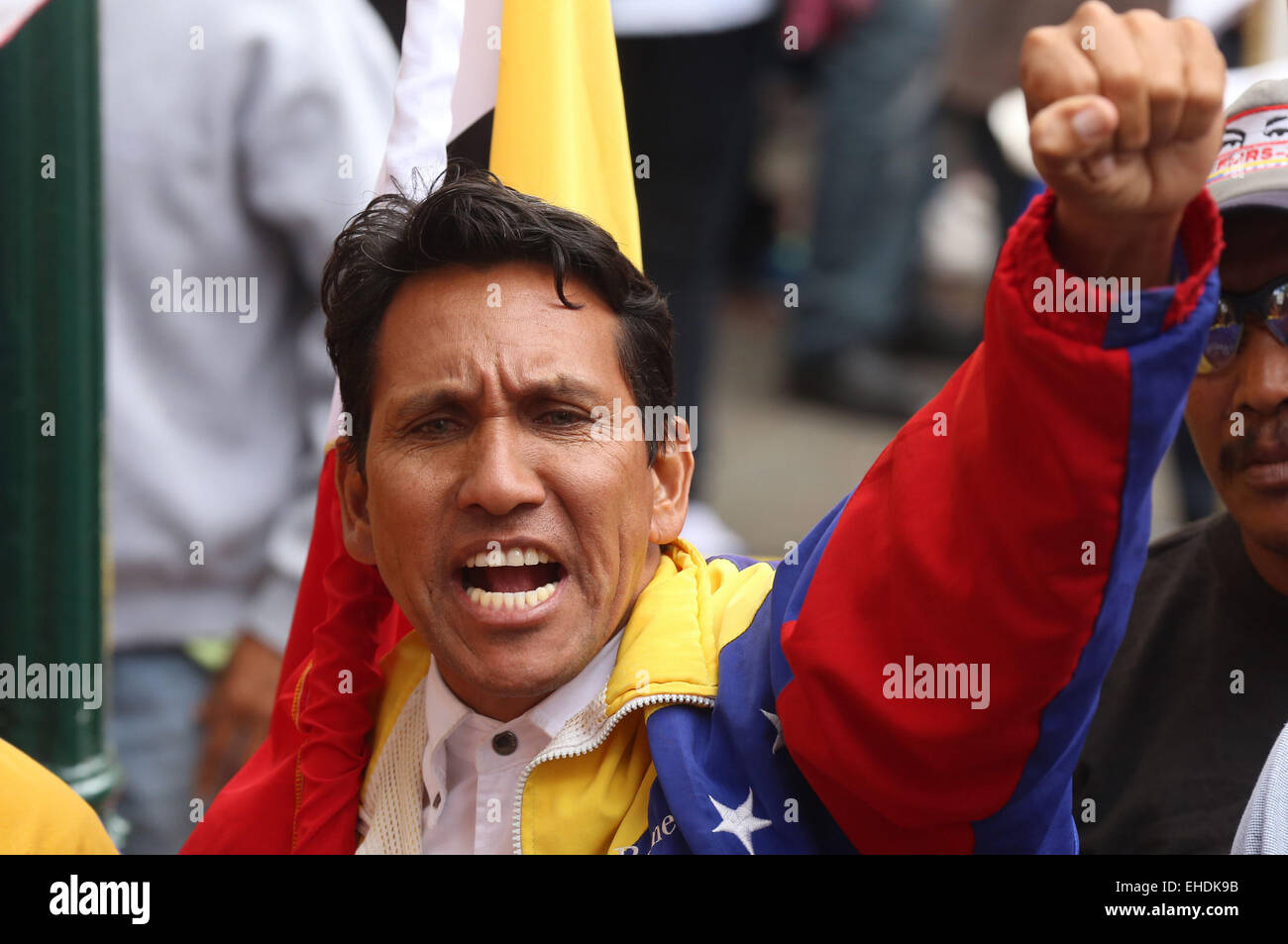 Caracas, Venezuela. 12th Mar, 2015. A resident shouts slogans during an 'anti-imperialist' march in Caracas, - Stock Image