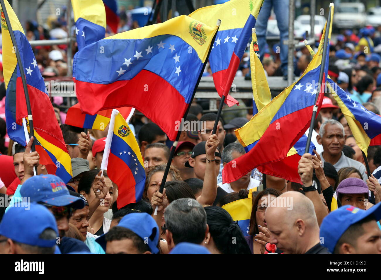Caracas, Venezuela. 12th Mar, 2015. Residents hold Venezuelan national flags during an 'anti-imperialist' - Stock Image