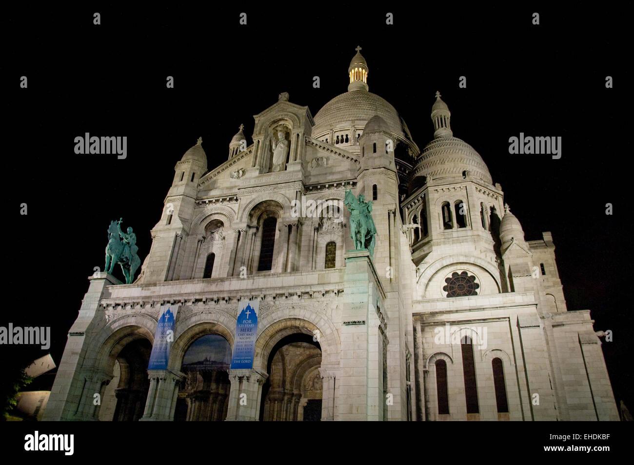 Night shot of Sacre Coeur in Paris France Stock Photo