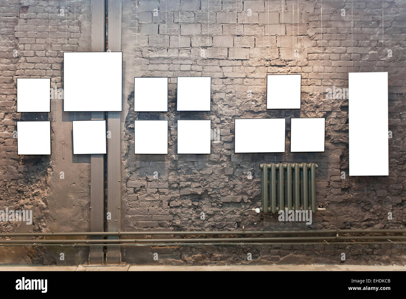 Empty frames on brown brick wall in museum Stock Photo: 79591243 - Alamy