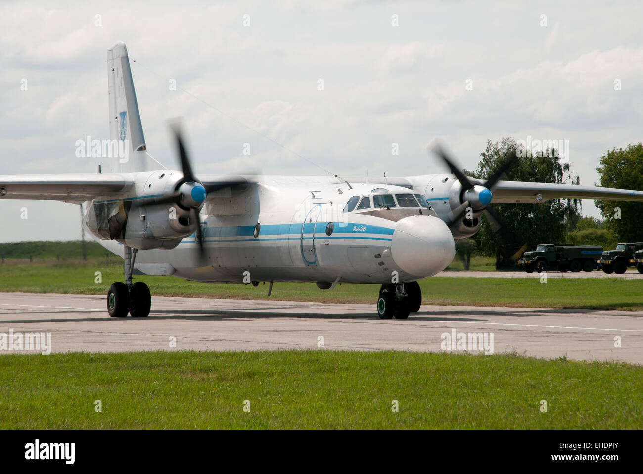 Aircraft Antonov An-26 Ukrainian Air Force  was taxiing to the runway. - Stock Image