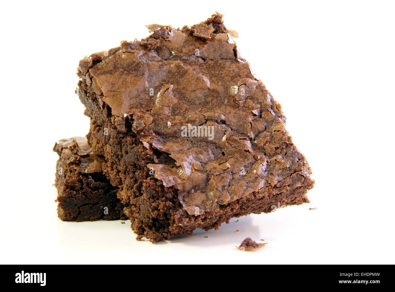 Freshly baked chocolate fudge brownie squares on a white background - Stock Image