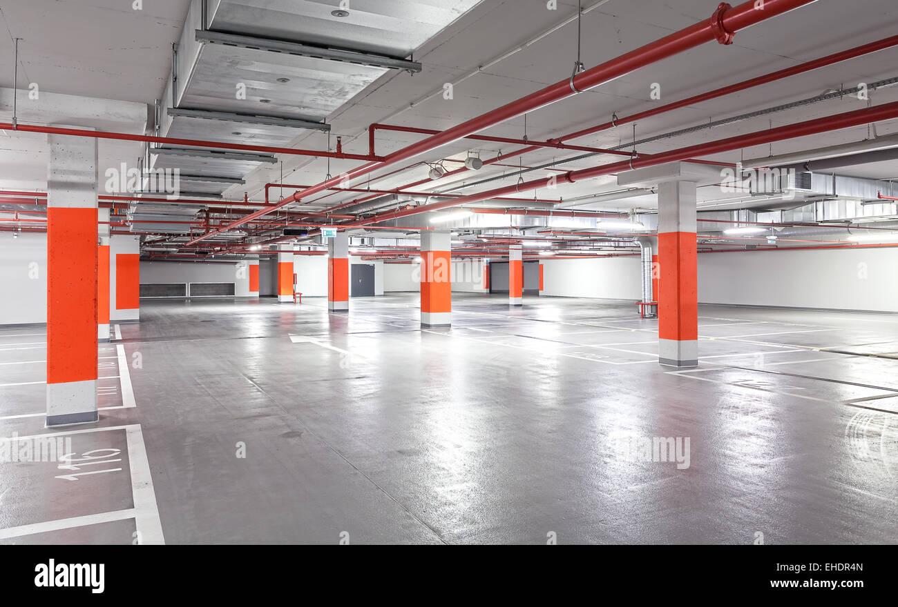 Photo of underground parking, industrial interior background. - Stock Image