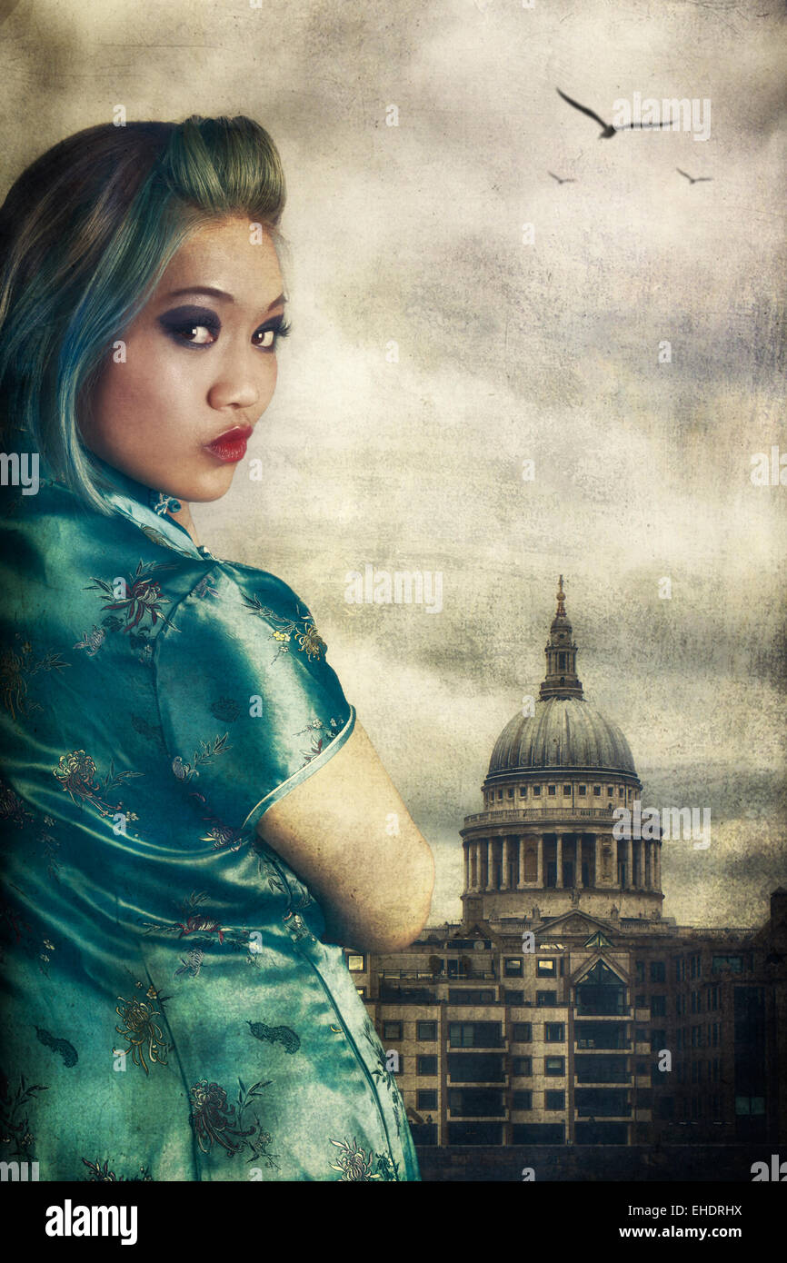 Woman wearing a Cheong Sam outside  st Paul's cathedral Stock Photo